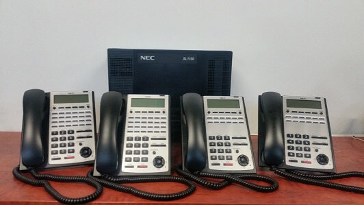 NEC SL1100 phone system with 4 handsets