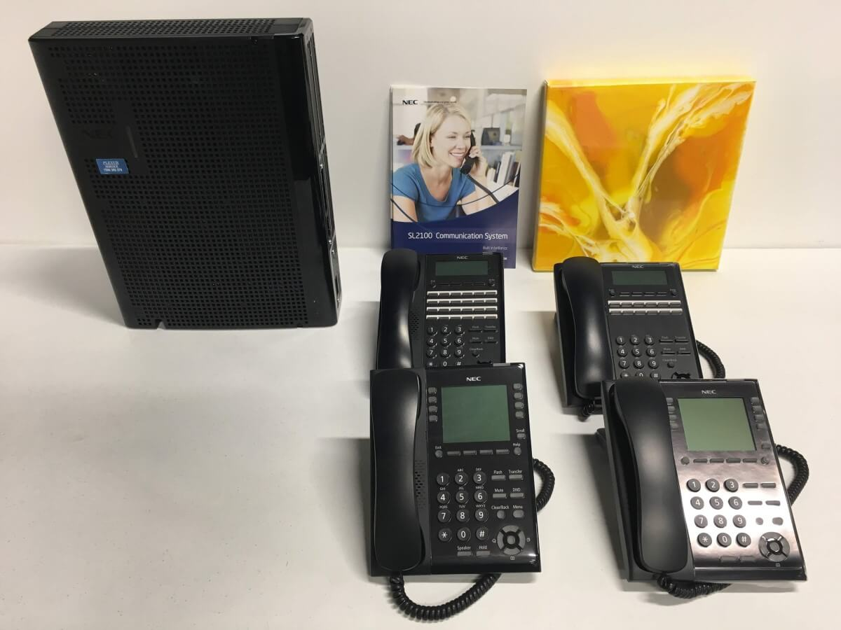 NEC SL2100 Phone System with 4 Phones
