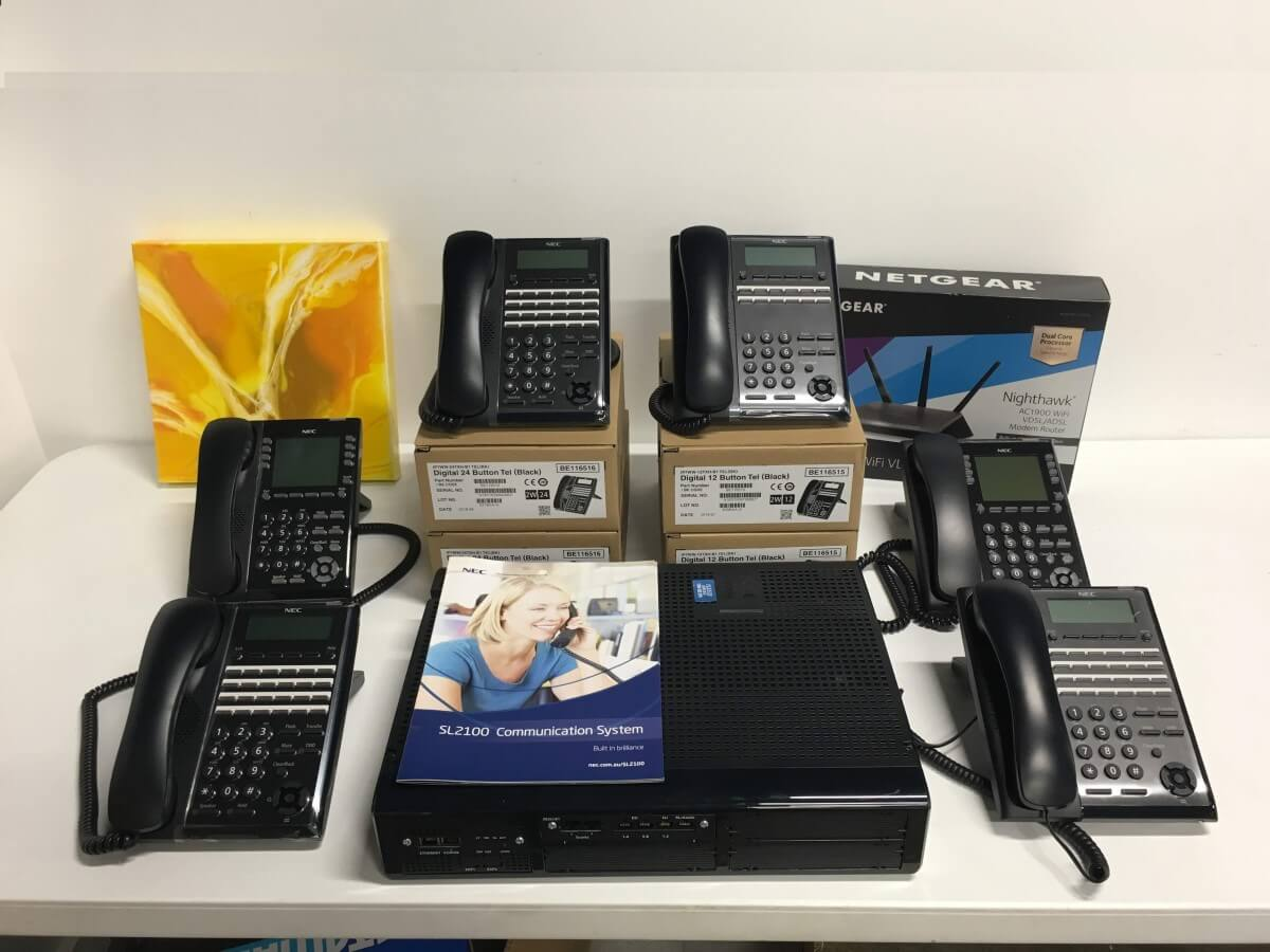 NEC SL2100 Phone System with 6 Phones and Router