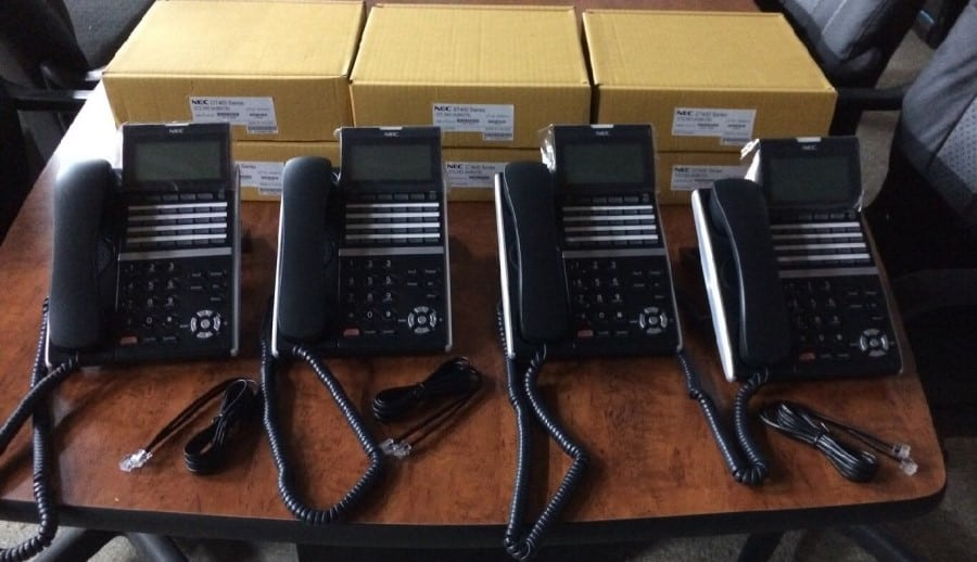 SV9100 phone system with 6 executive handsets
